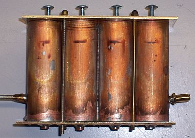 The four tubes soldered to the bottom plate